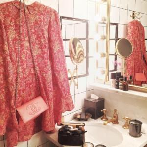 Dress and Chanel bag in designer bathroom