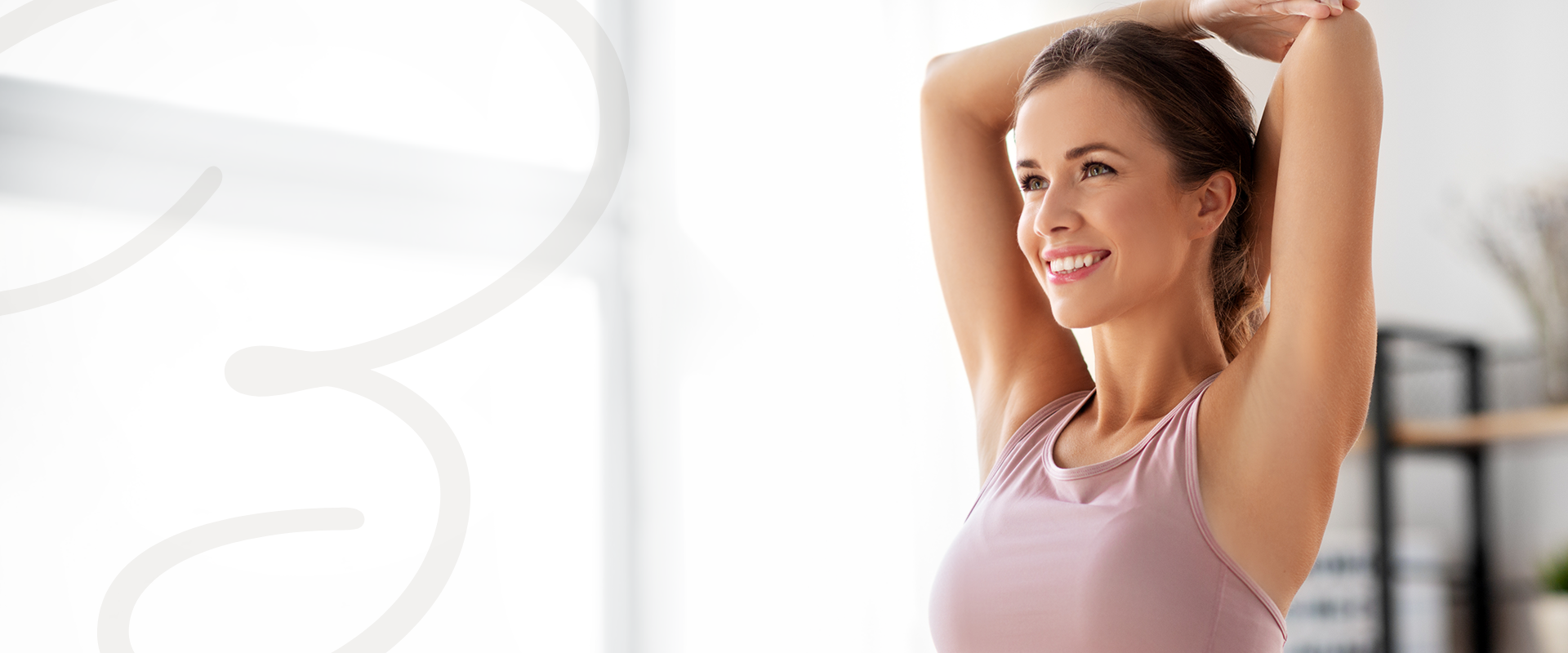 Beautiful, smiling woman with smooth skin after laser hair removal