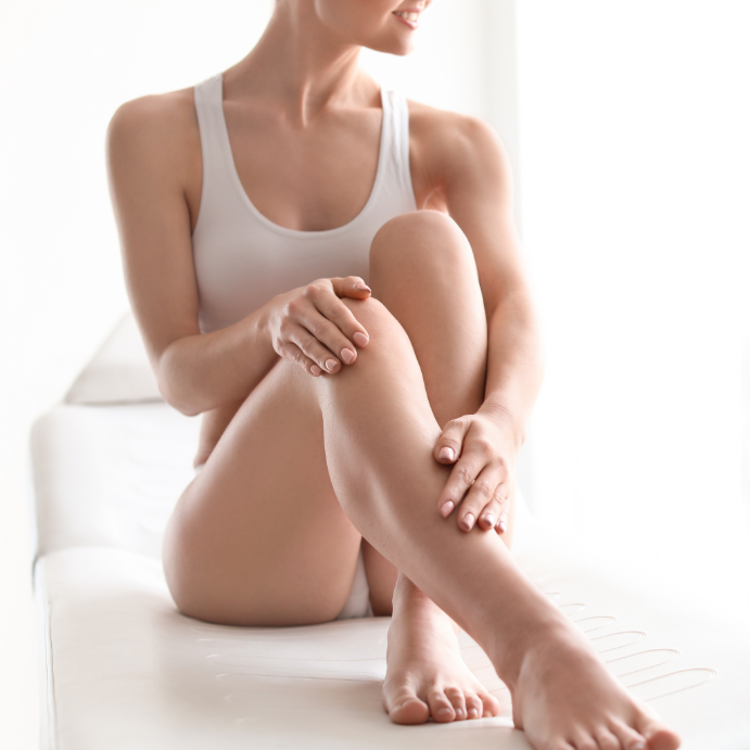 Body portrait of woman with crossed legs showing off her smooth, hair-free skin