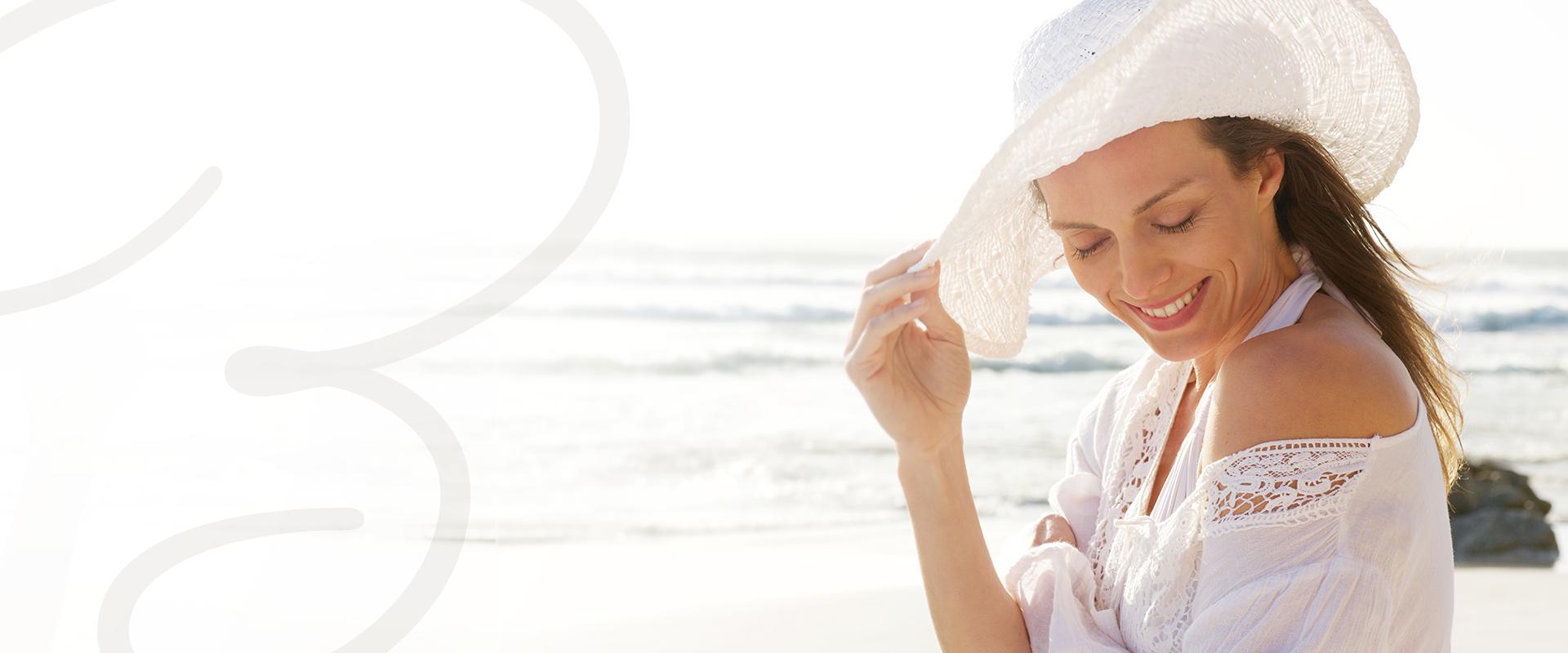 Beautiful woman / med spa customer at the beach happy to have chosen Bellamedica in Kirkland, WA