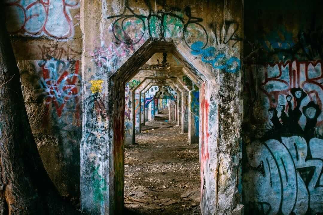 Dark urban corridor with graffiti