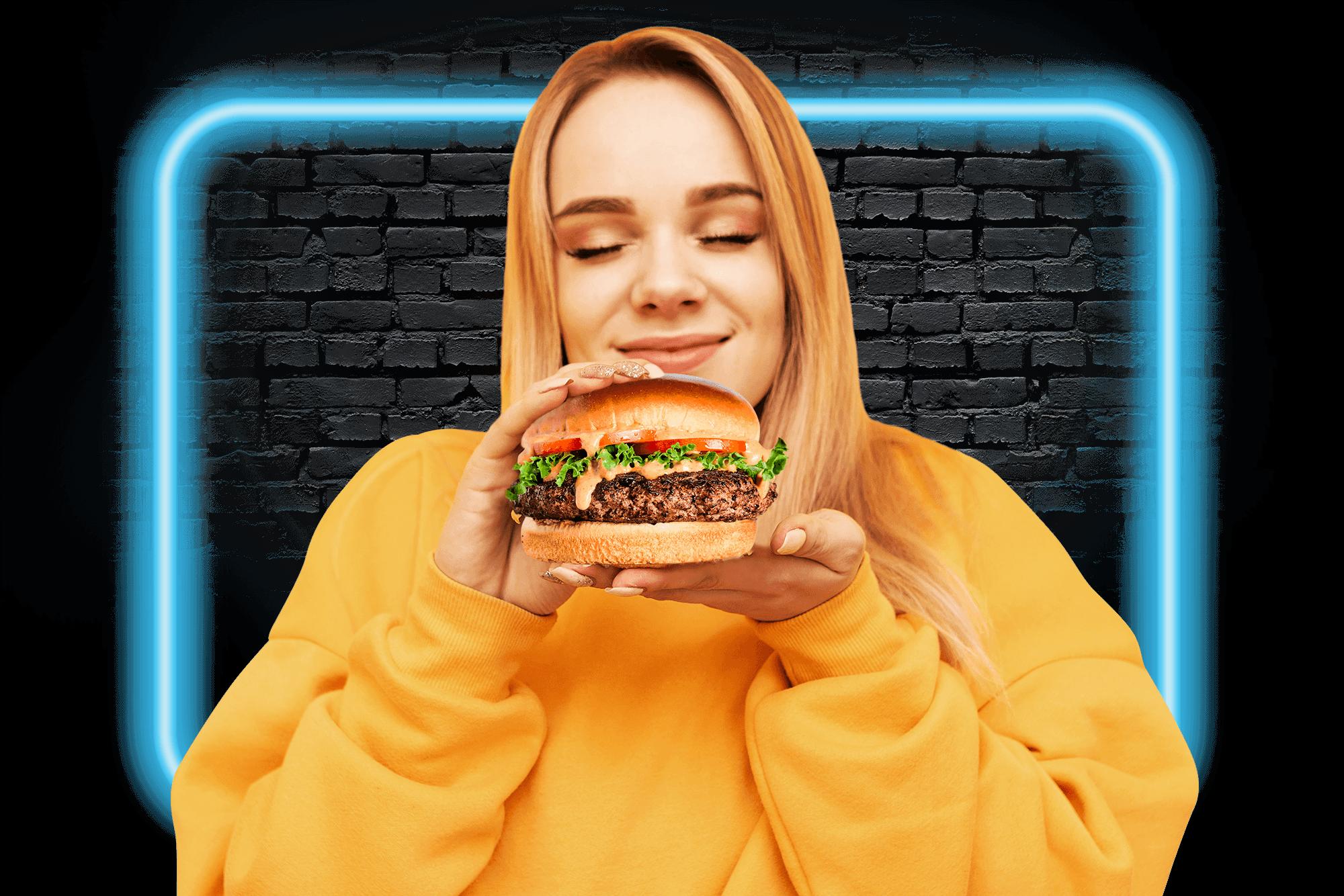Girl holding burger