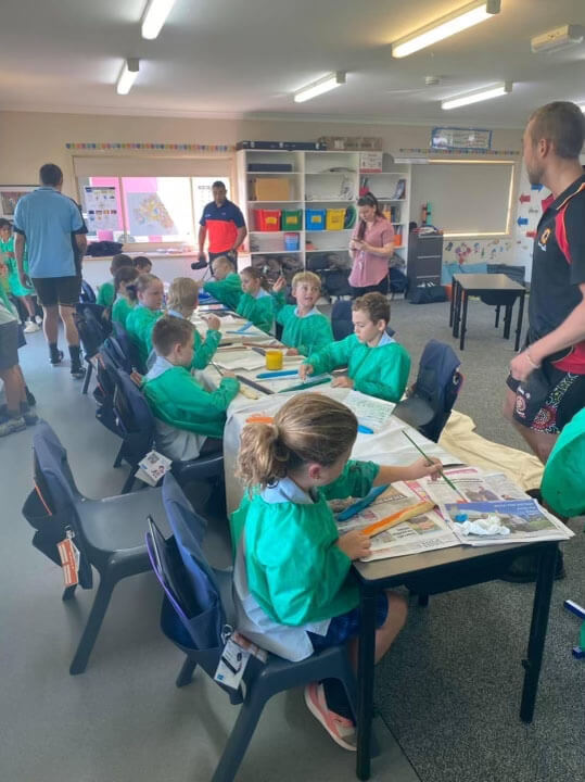 Hunter Barnes educating in a school