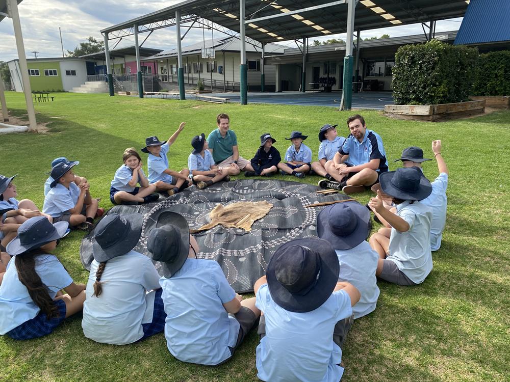 Khan Barnes teaching a group of school students
