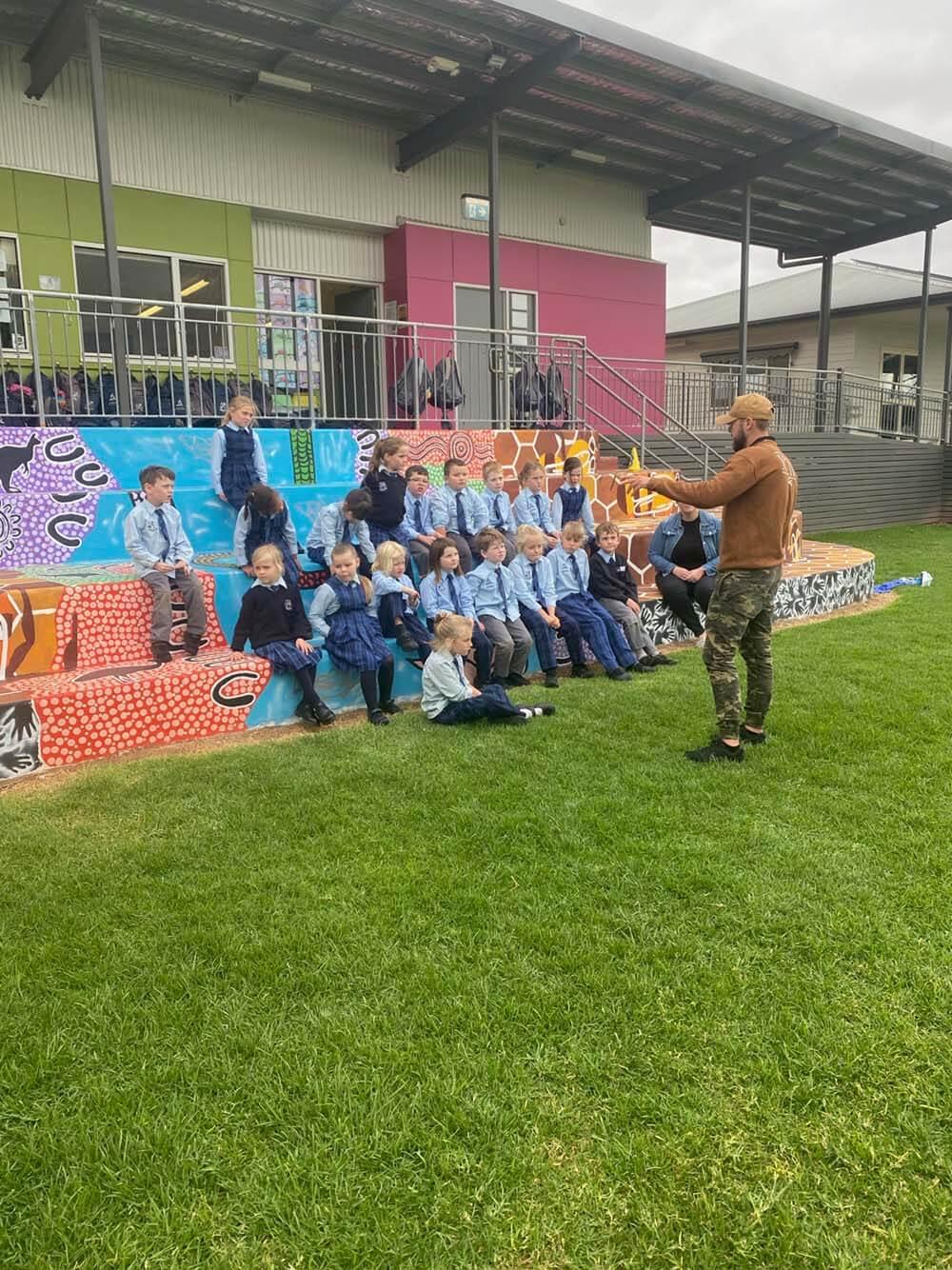 Hunter Barnes teaching a group of kids