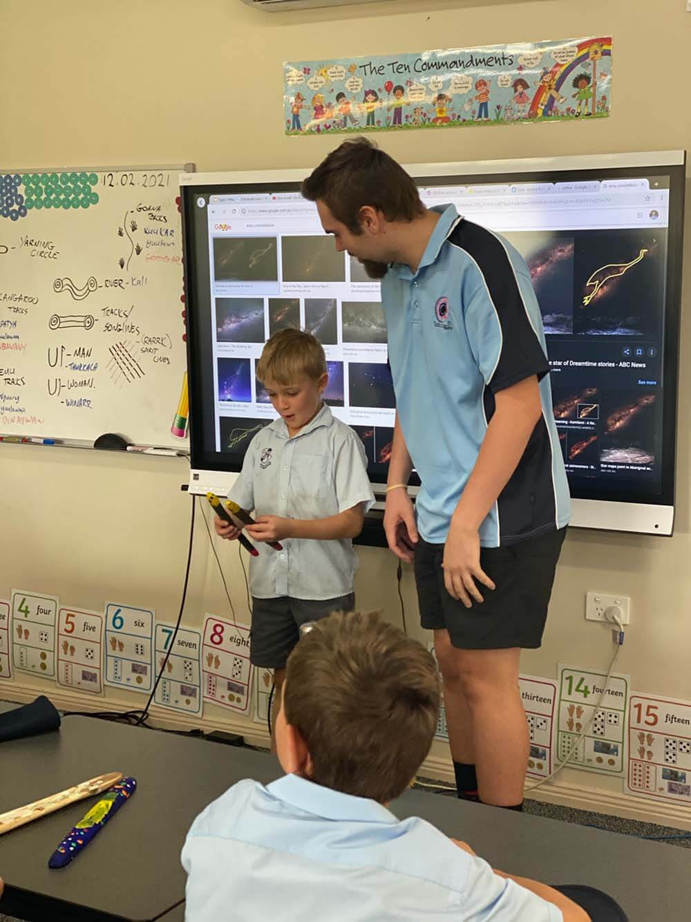Khan Barnes helping a school student present