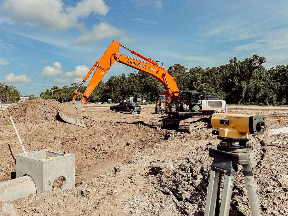 orange digger and surveyer