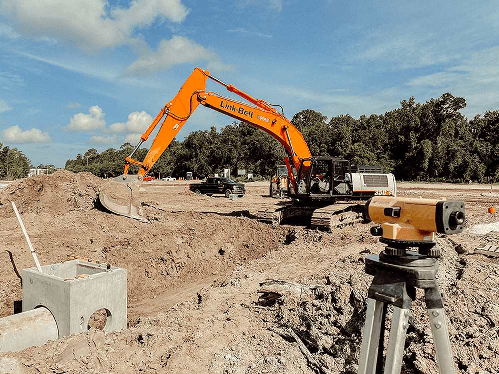 orange digger and survey