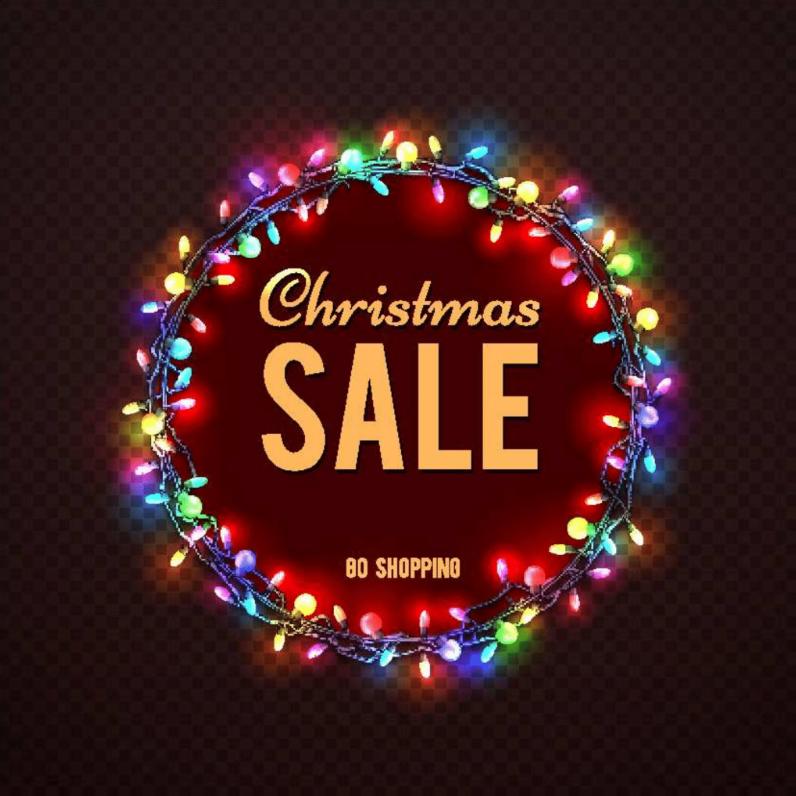 Надпис Коледни разпродажби, ограден с коледни лампички