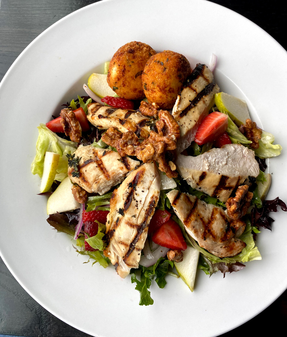 Grilled Chicken & Goat Cheese Salad, Pears, Candied Walnuts, Sliced Strawberries, FriedGoat Cheese, Onion, Red Wine Vinaigrette
