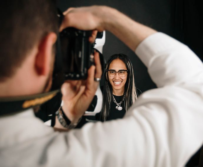 Photo of Dr. Ritter taking a headshot of a patient
