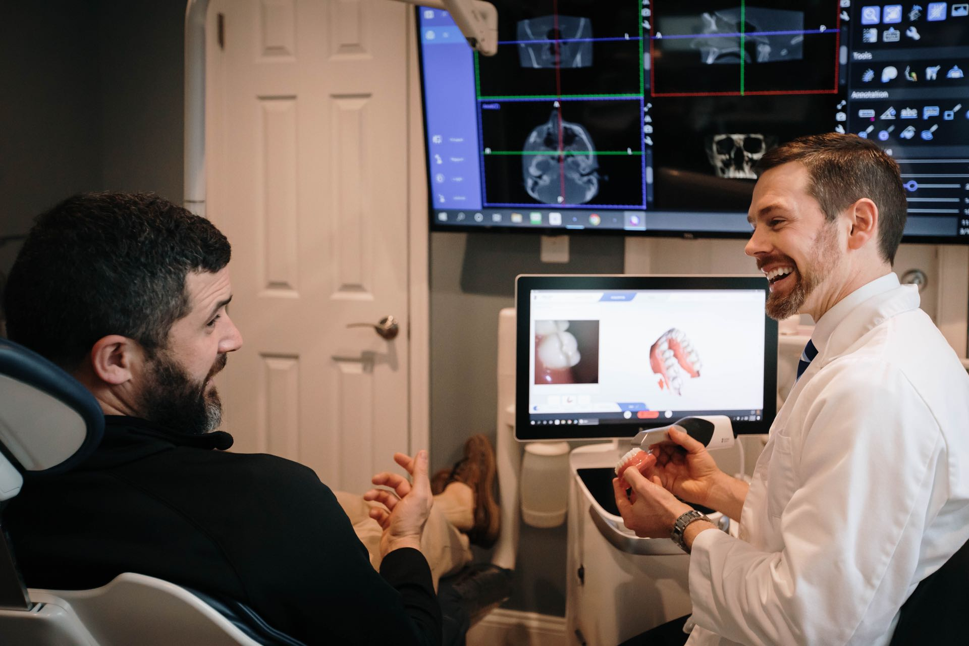 Photo of Dr. Ritter showing a patient a model