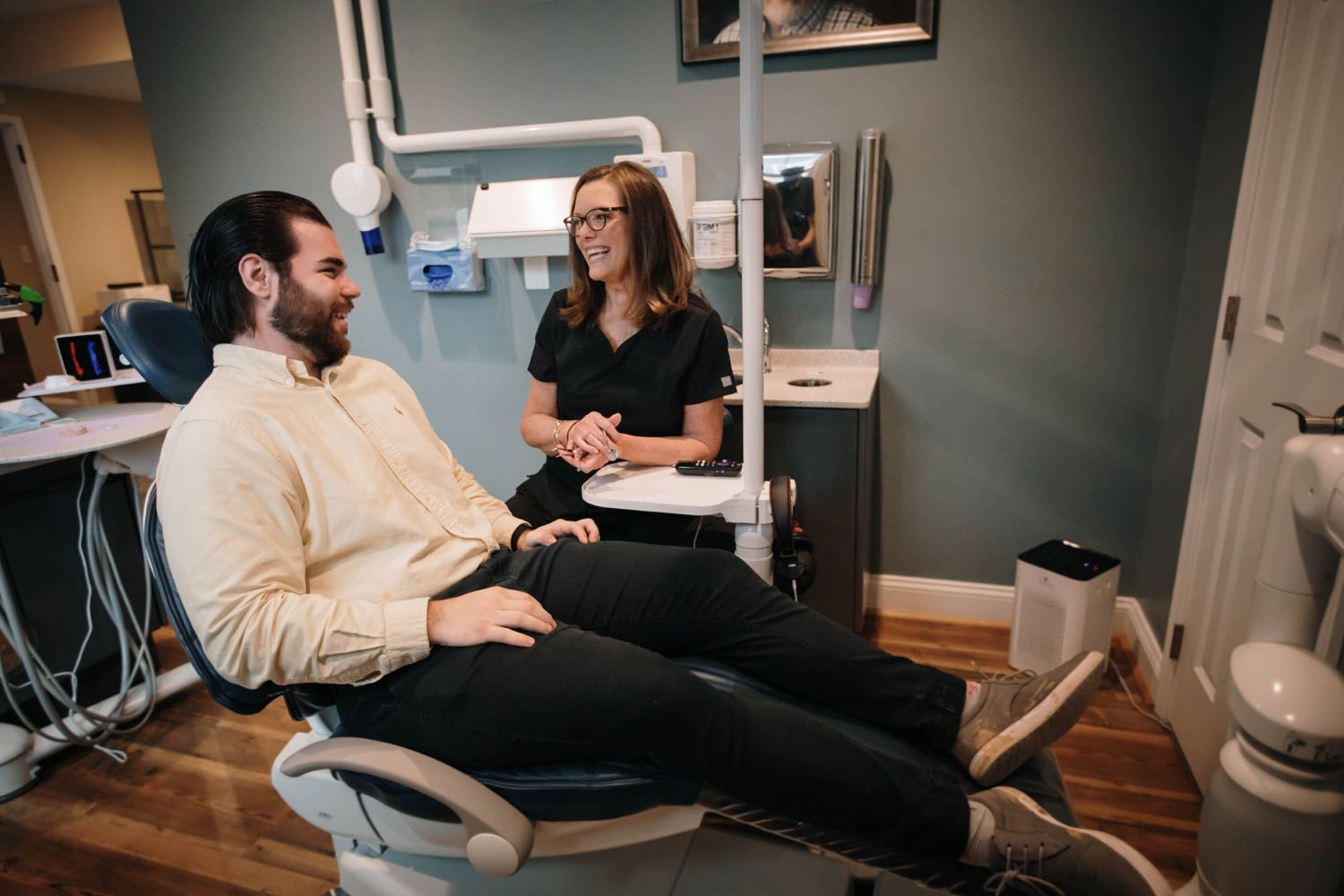 Photo of an assistant talking with a patient