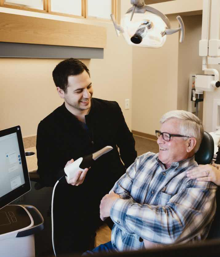 Photo of Dr. Majidian preparing to take a digital impression of a patient