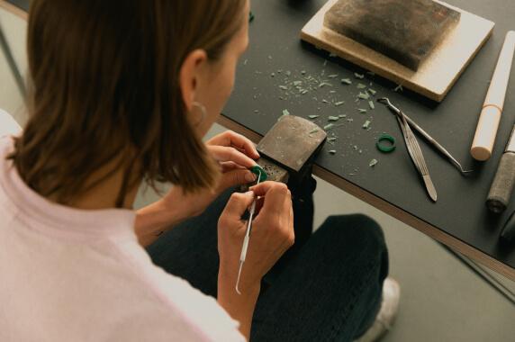 Artisan processing a piece of metal