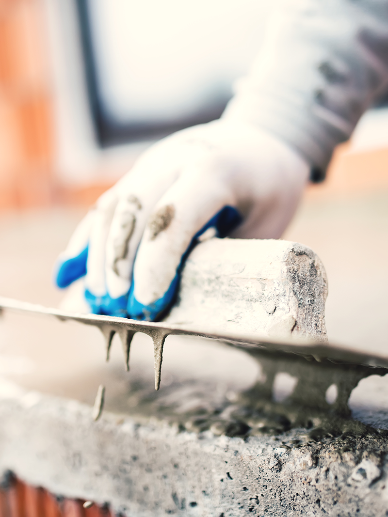 A worker finishing concrete