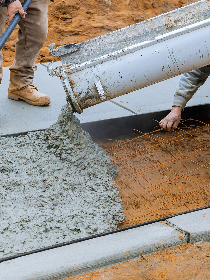 Workers laying concrete