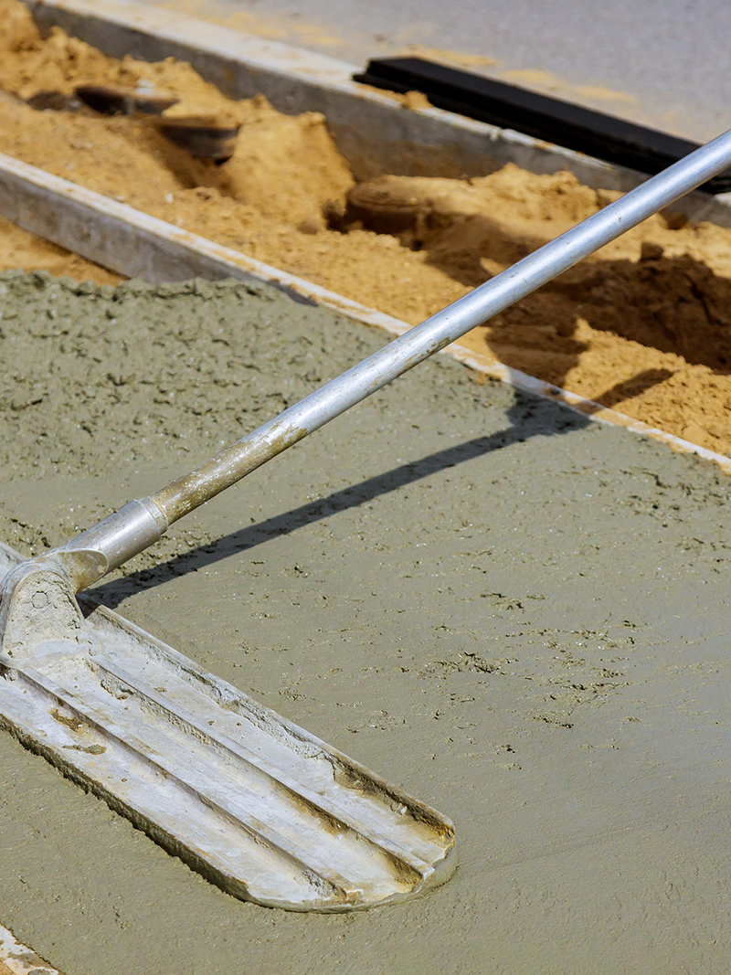 A worker smoothing out concrete