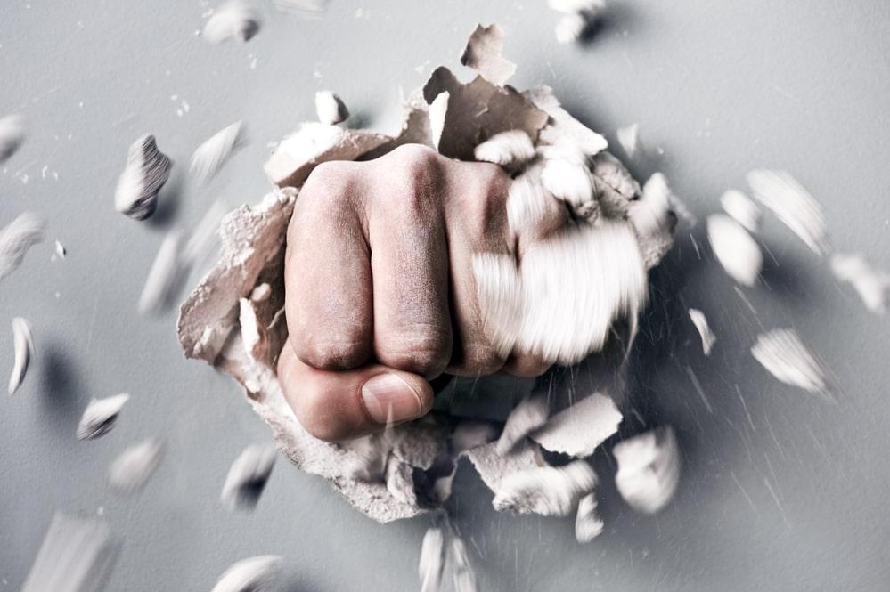 fist bursting through a wall