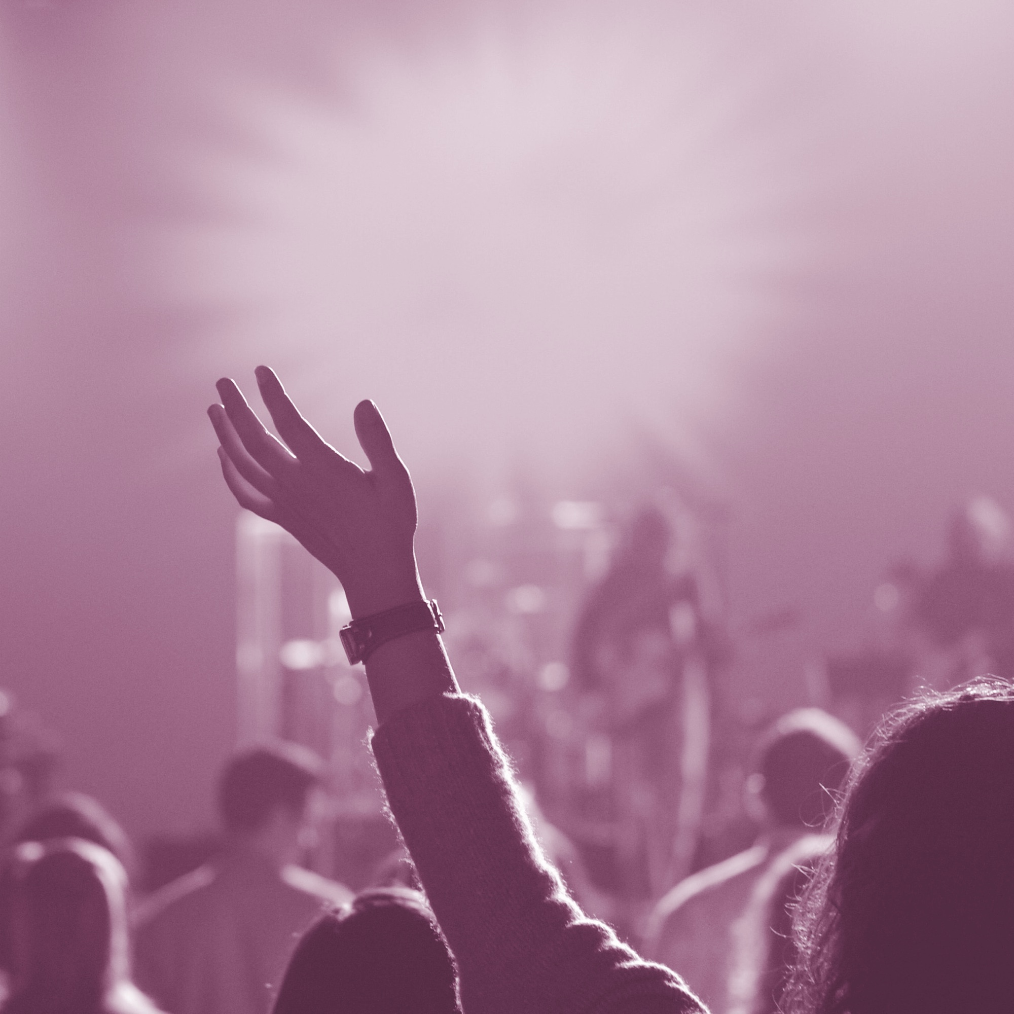 A person in worship, with their hands raised