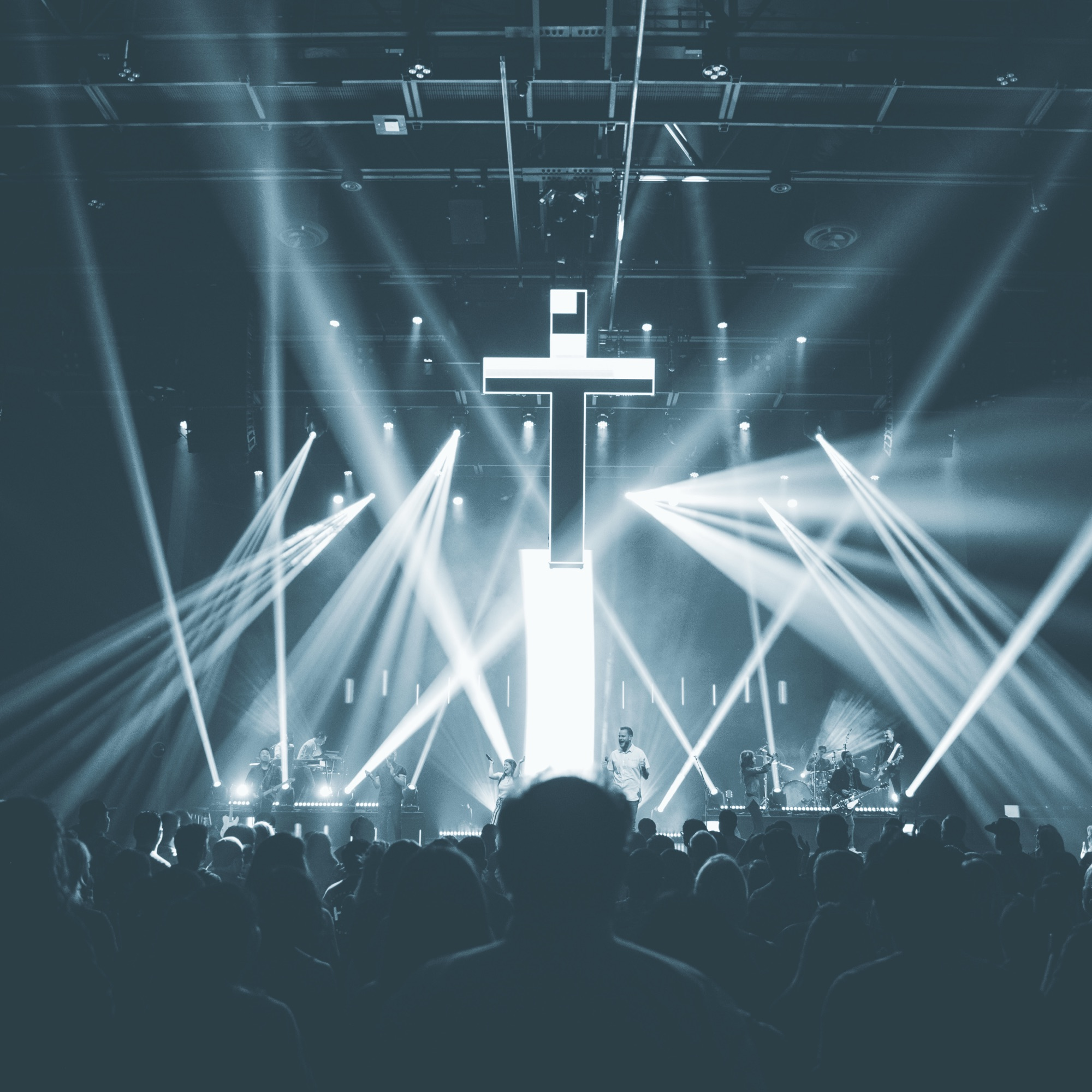 A cross lit up on a stage