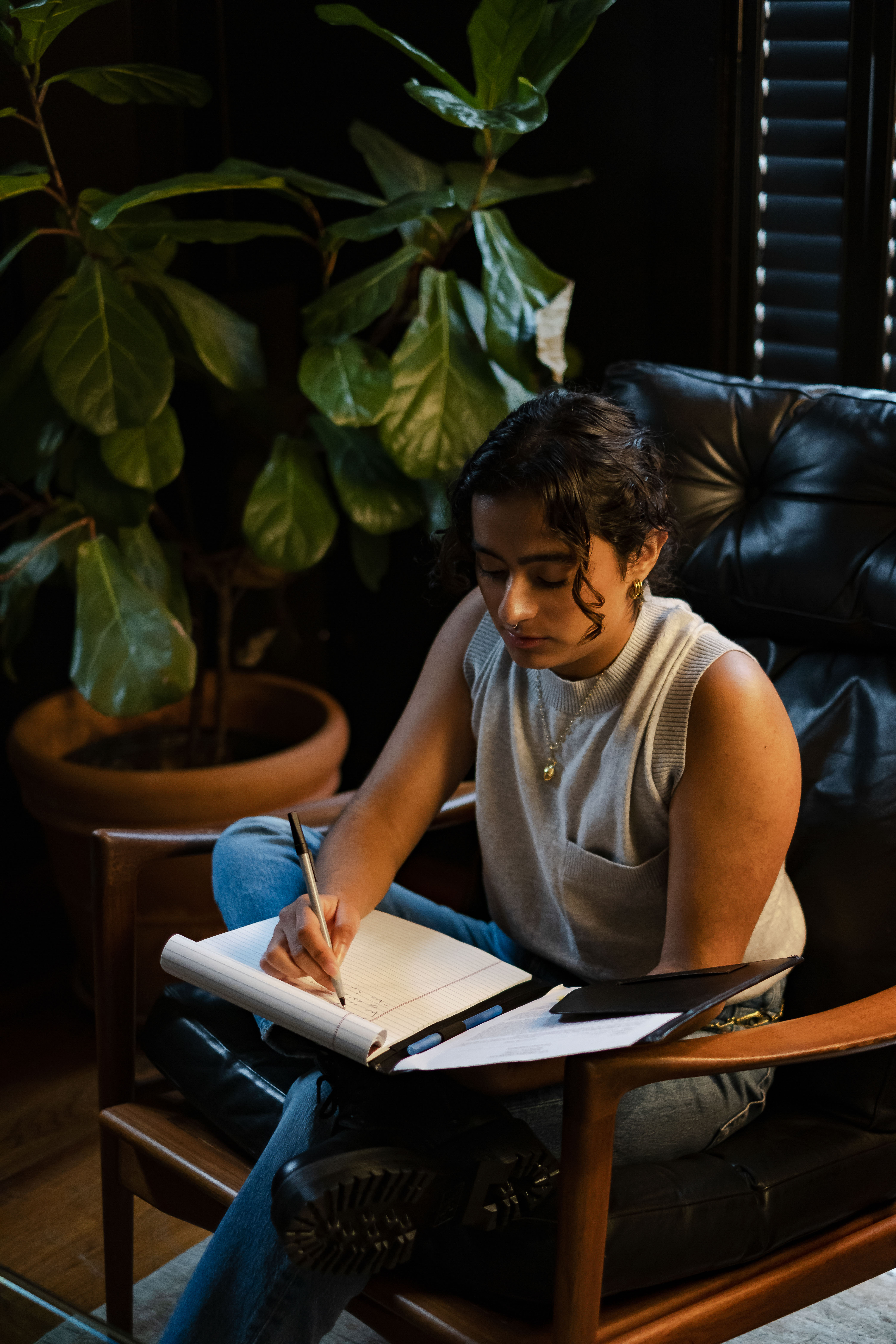 A transmasculine therapist taking notes