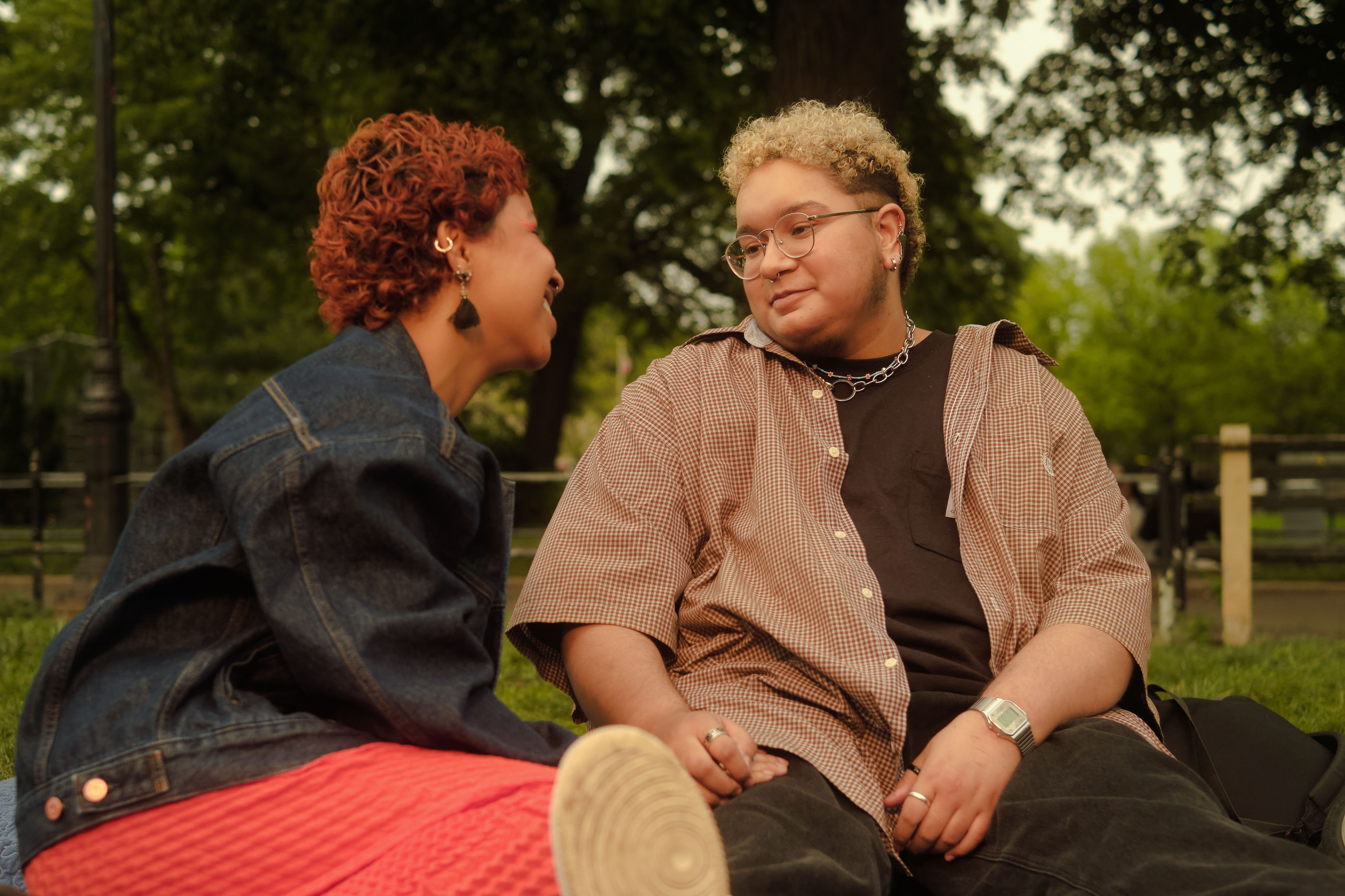 A trans couple sharing a moment in the park
