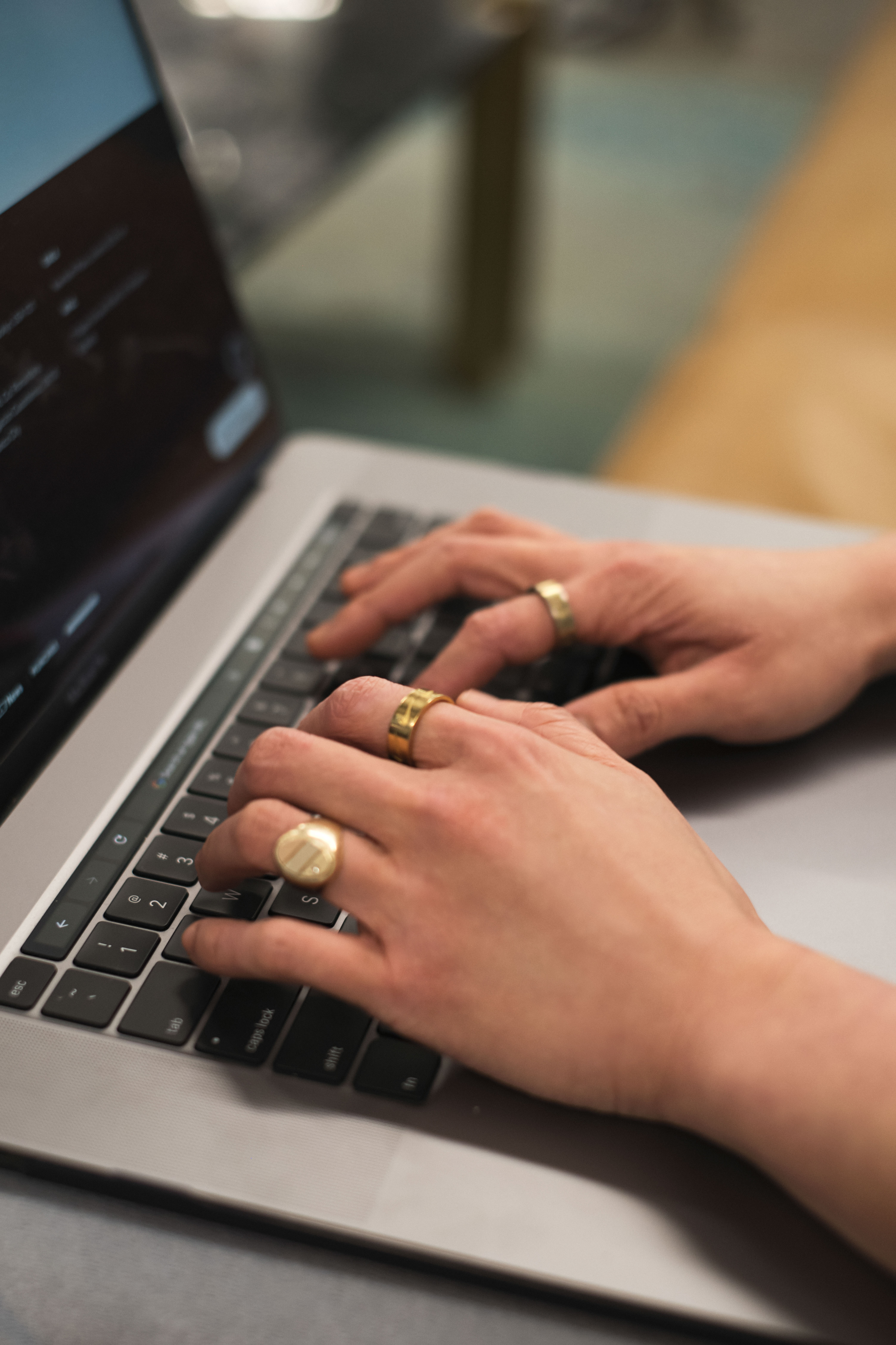 Close-up of a non-binary person using a laptop