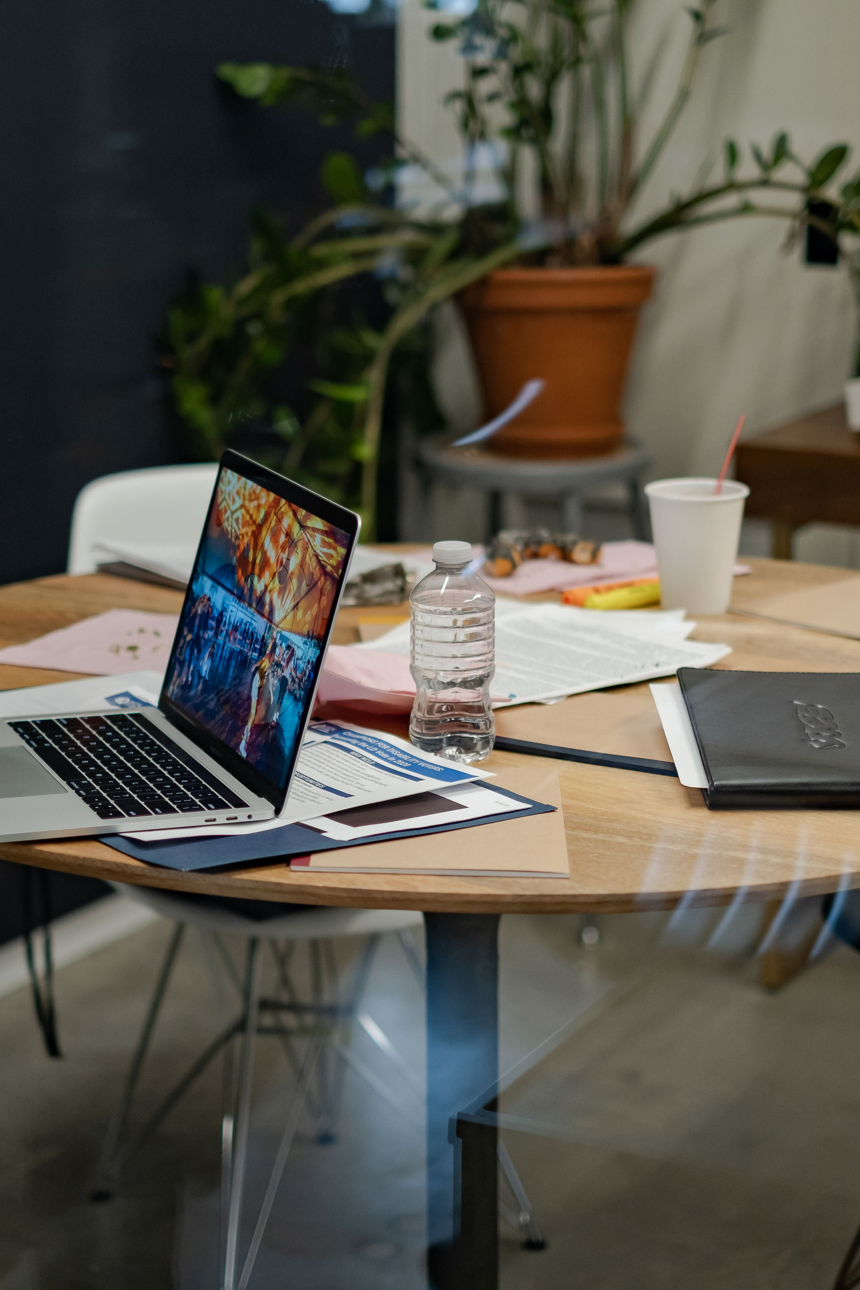 A laptop and notebook in an office space