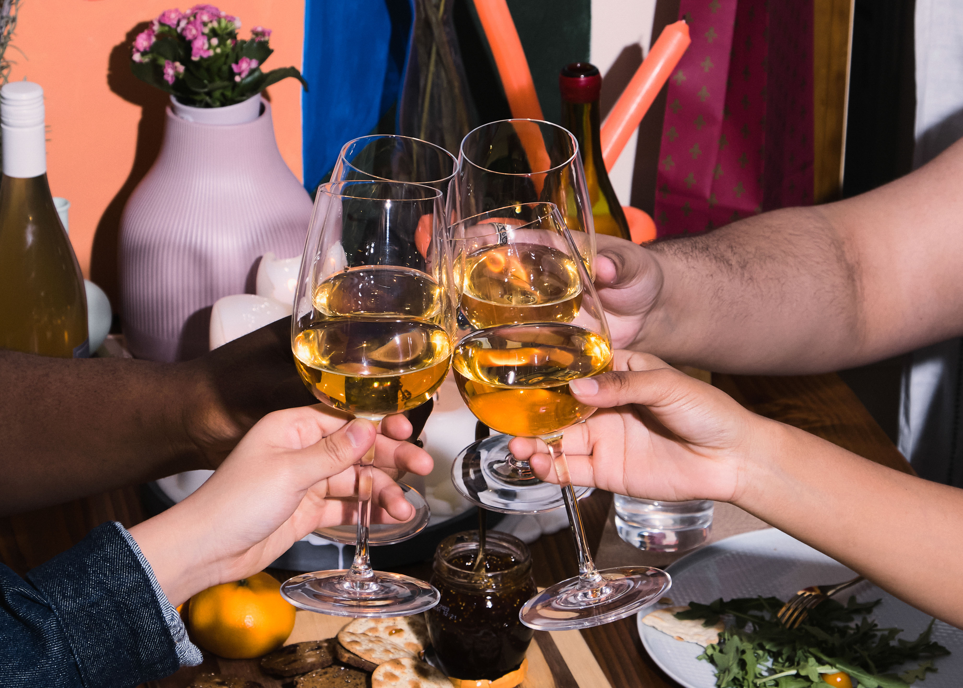 A group of friends of varying genders celebrating at a dinner party(1)