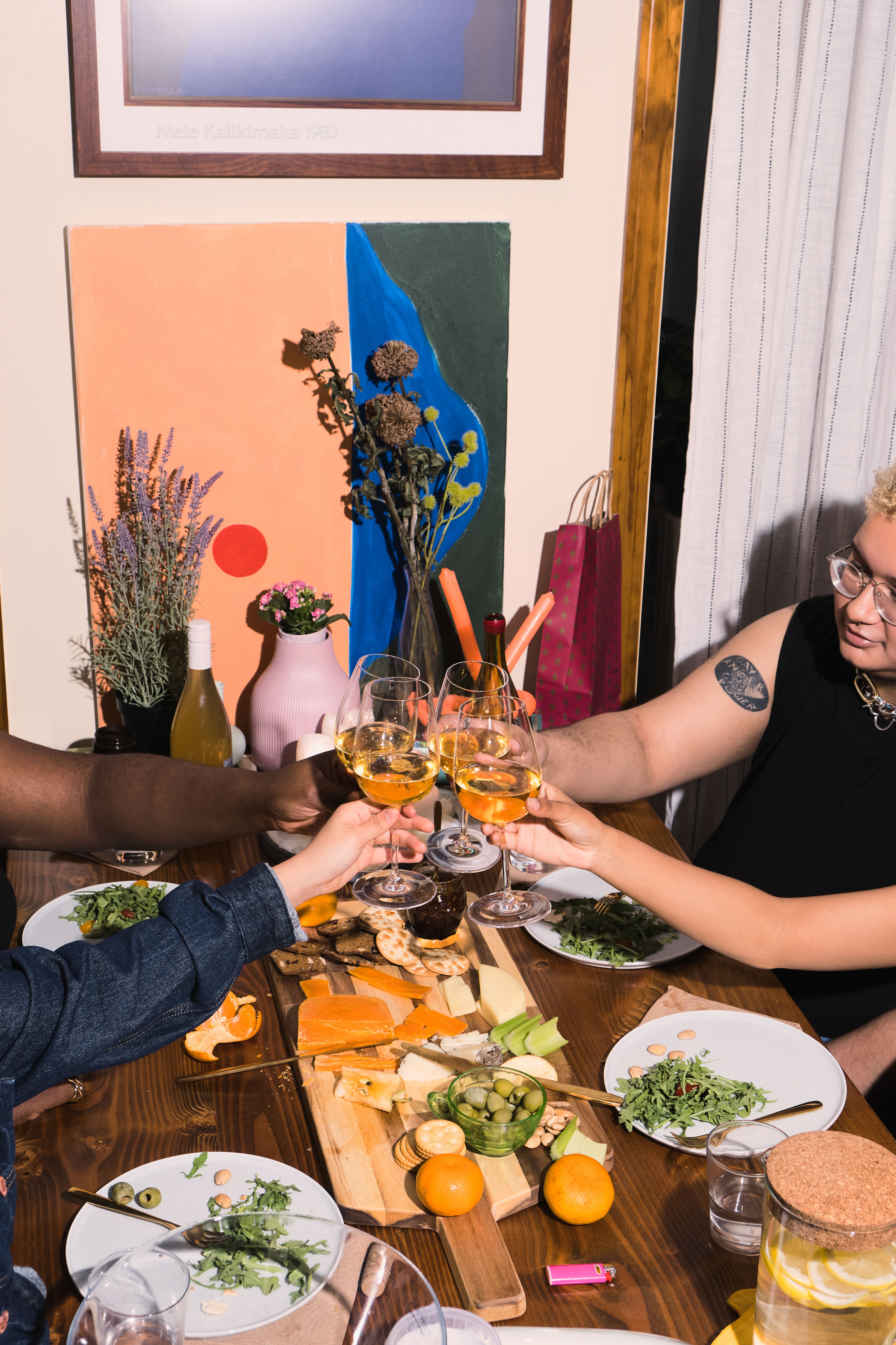 A group of friends of varying genders celebrating at a dinner party(2)