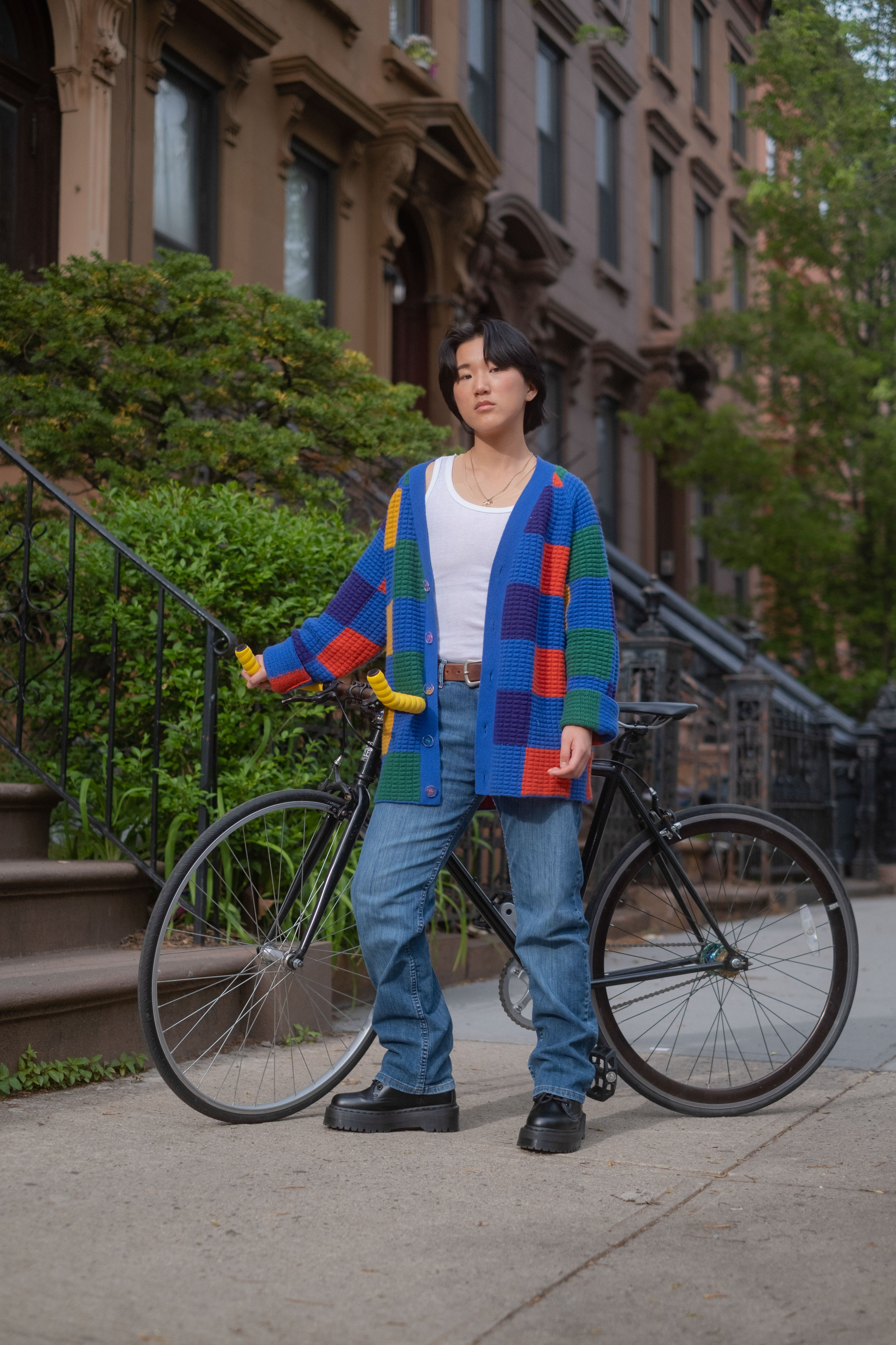 A non-binary trans man standing outside with a bicycle(1)