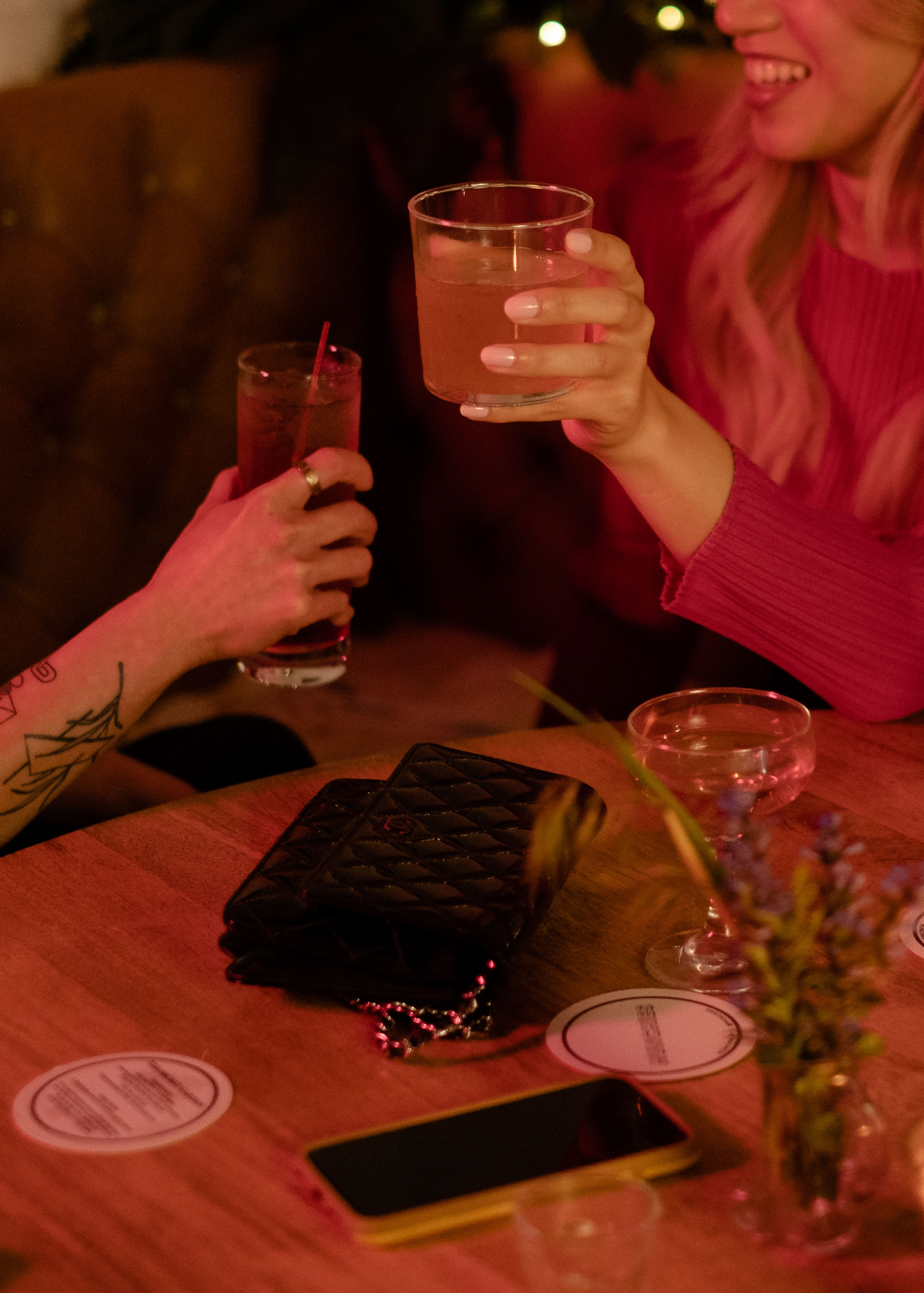 A transfeminine person having drinks with friends