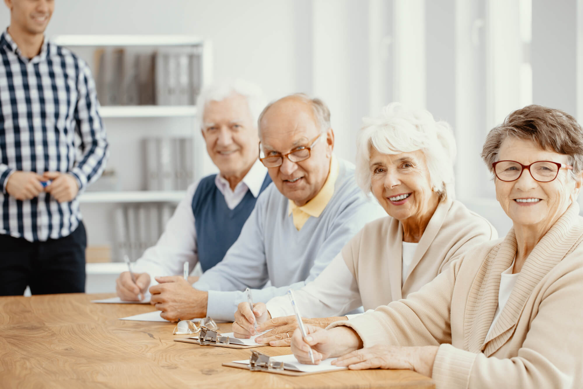 Group of elderly people sitting together at Private Nursing Care New York City
