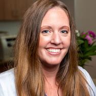 A headshot of Dr. Jennie Austin smiling.