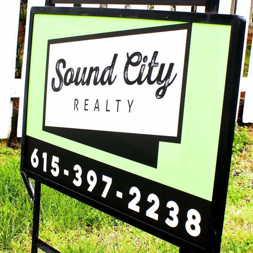 A photo of the sound city lawn sign with their logo and phone number.
