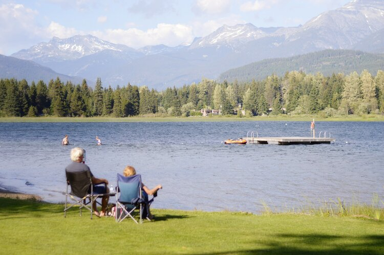 family sat by the lake in Whistler BC