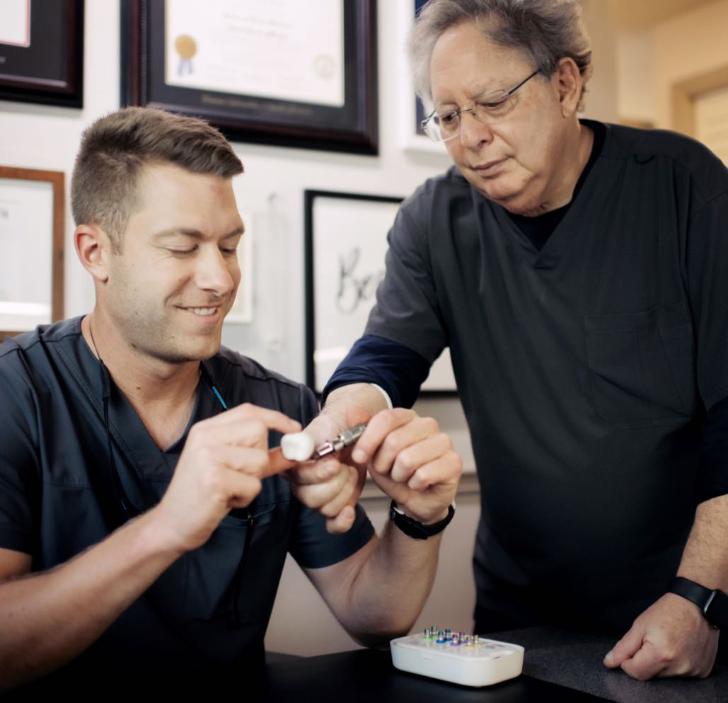 Photo of Dr. Mitchell working with dental tools