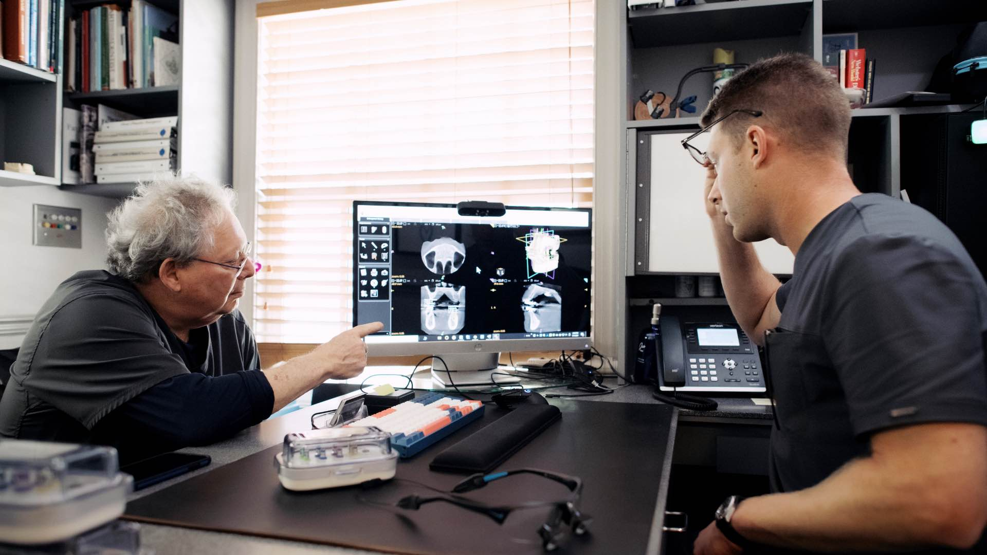Photo of Dr. Mitchell reviewing digital scans