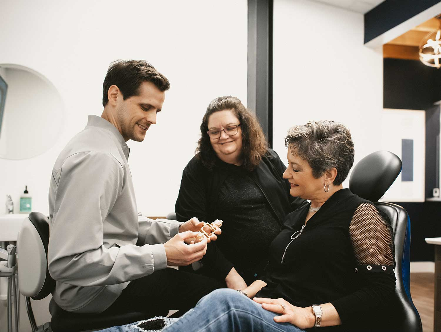Photo of Dr. Johnson showing a patient a model