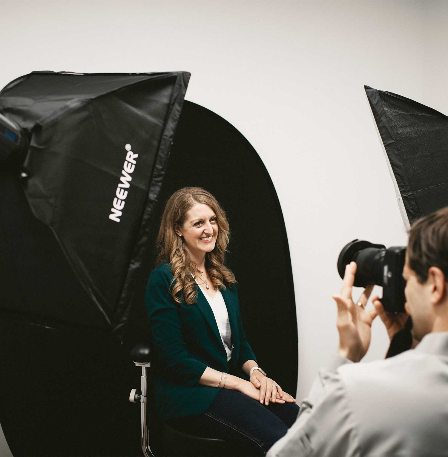 Photo of a patient getting a headshot taken