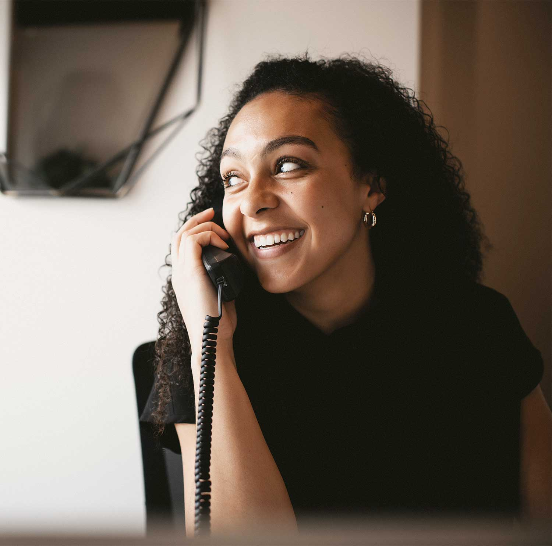 Photo of a Neighborhood Dental team member on the phone