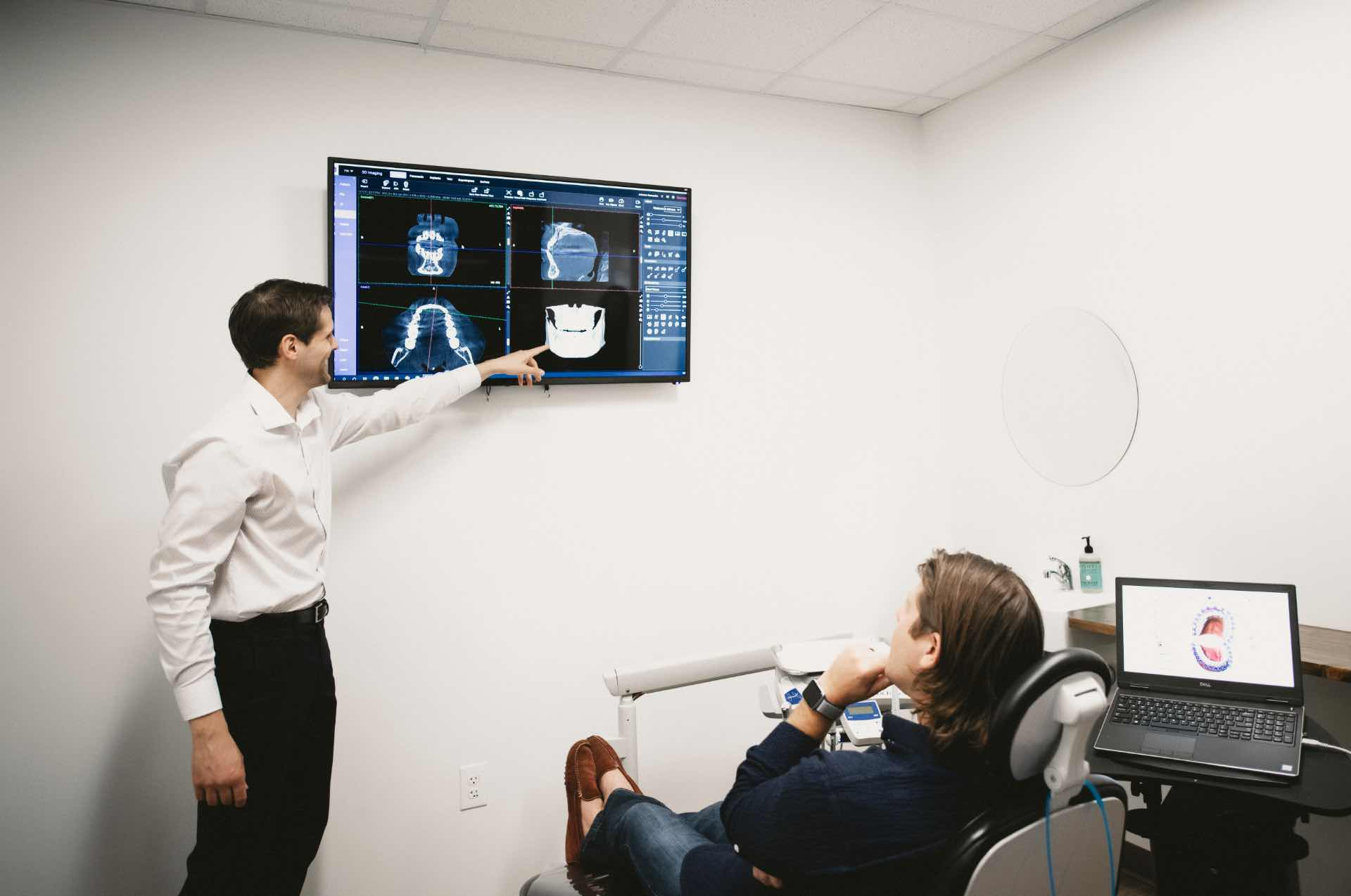 Photo of Dr. Johnson reviewing scans with a patient