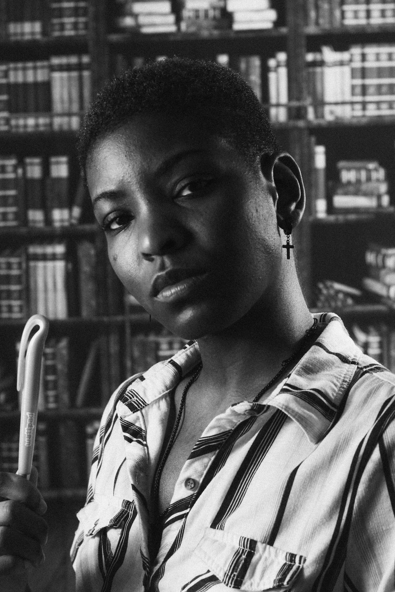 Portrait of a black female model inside a library.