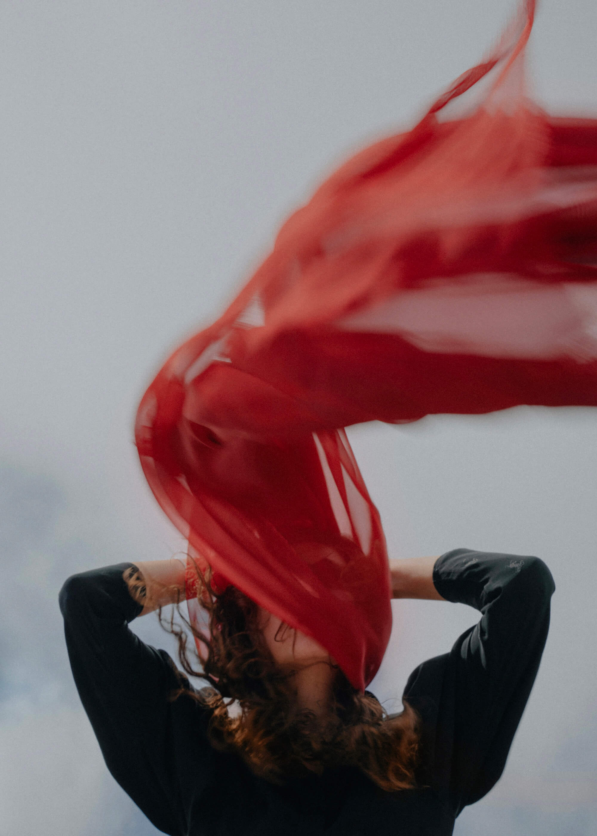 Portrait of girl with red fabric during Belarus protests by Krystsina Shyla, winner of the Beazy November Contest