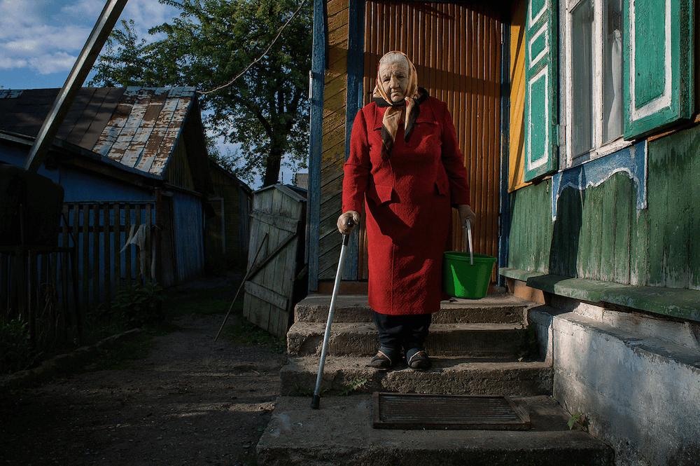 Portrait of grand mother in Belarus by photographer Krystsina Shyla
