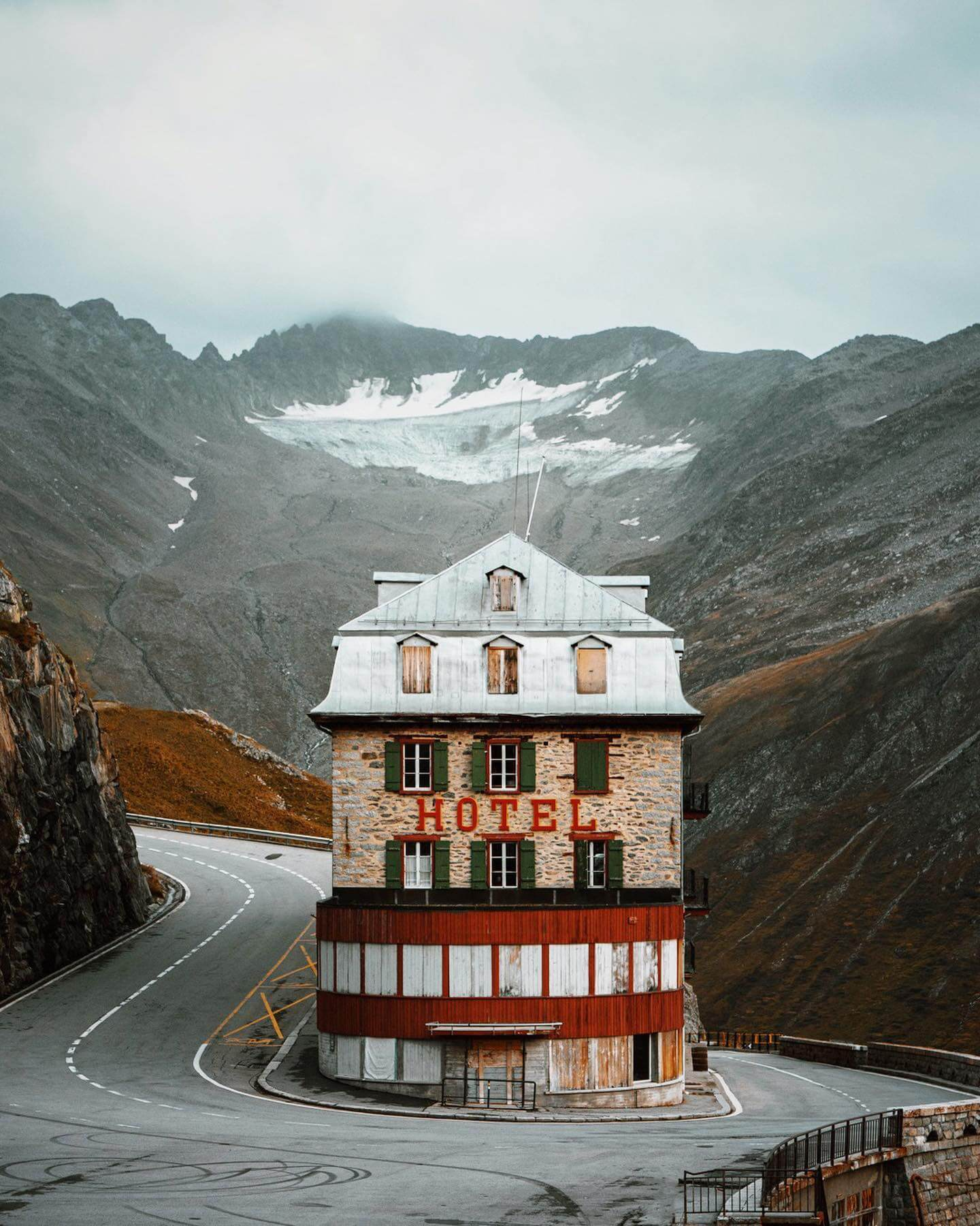 Hotel building, snow landscape, mountains