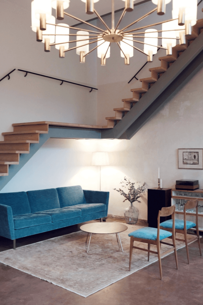 Artist loft with huge staircase available for rent for your next film production in Berlin, Germany. Minimalist and unique interior design