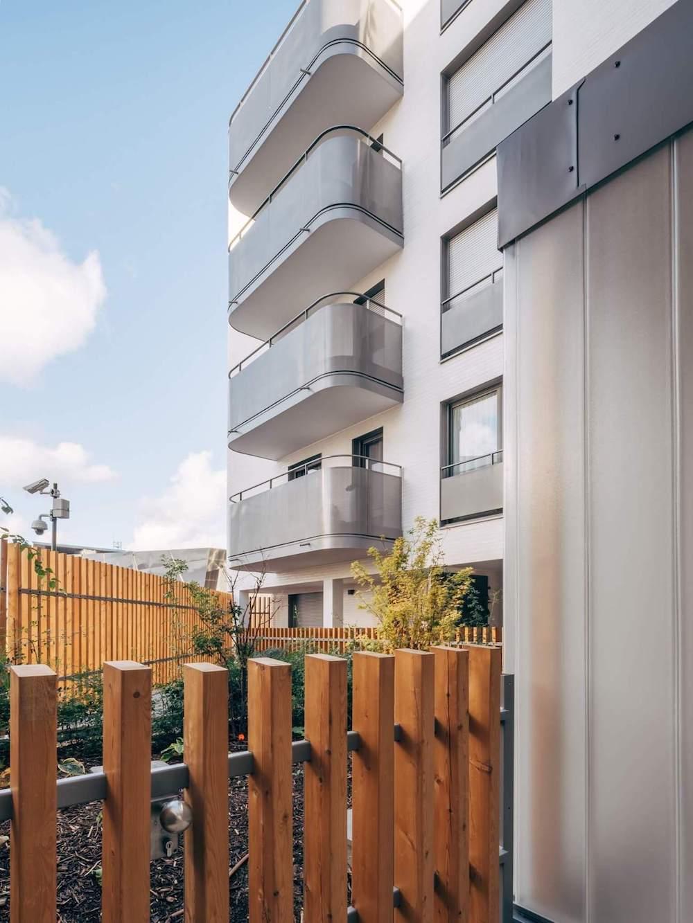 Interior garden in a building with metal balconies.
