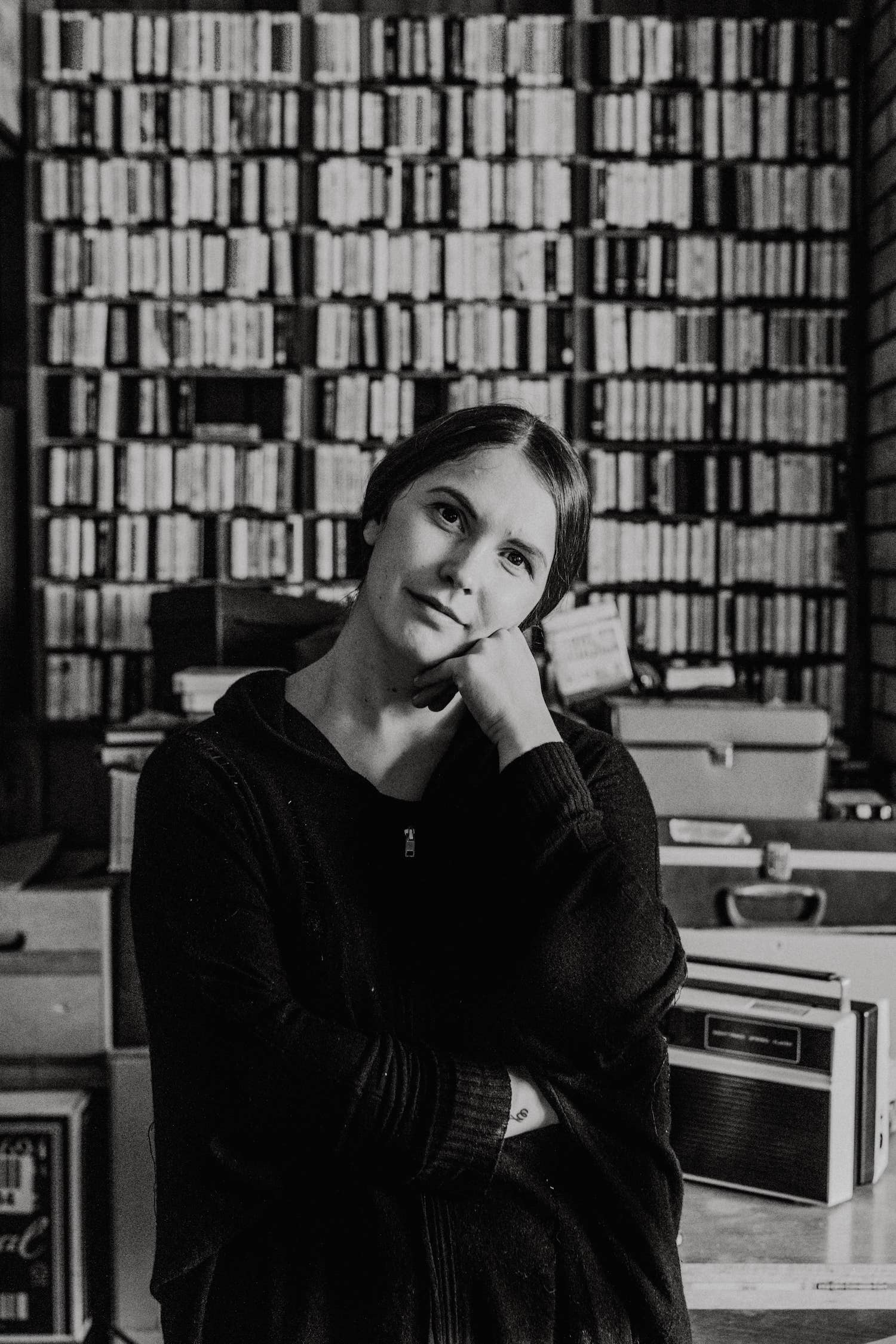 A thoughtful girl in a library.